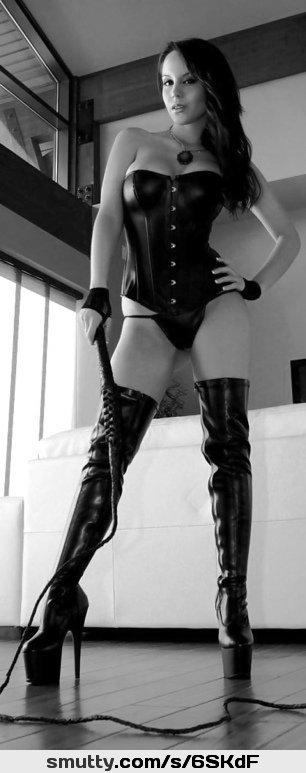 An image by: ludvig - Fantasti.cc #leather #corset #blackhair #BlackAndWhite #boots #heels #dominatrix #whip