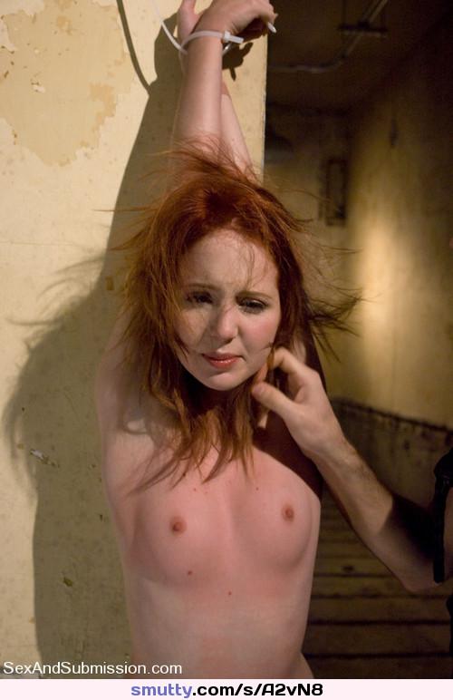 Wild redhead bondage