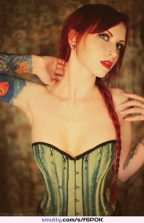 #redhead #redlips #spacer #greeneyes #paleskin #smalltits #corset #cleavage #tattoos #sleeve #ponytail #braid #collarbone #tinywaist #hips