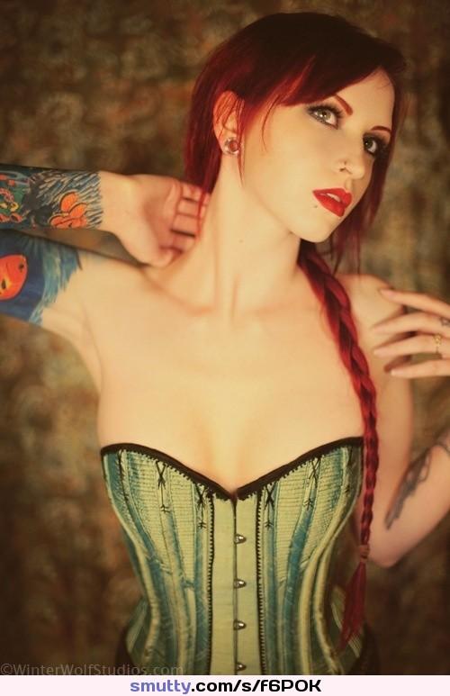 #redhead #redlips #spacer #greeneyes #paleskin #smalltits #corset #cleavage #tattoos #sleeve #ponytail #braid #collarbone #tinywaist #hips