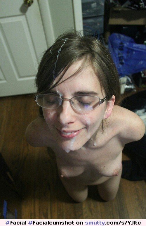 image Pretty nerd in glasses gets a mouthful of cum